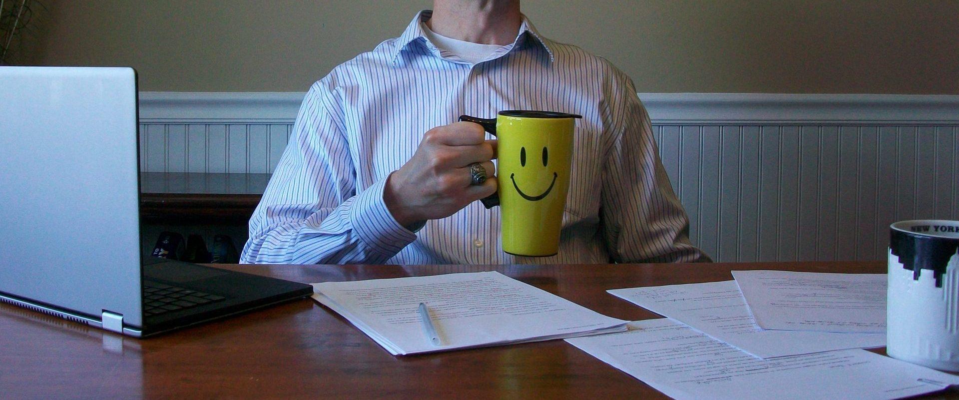 Author David McCaleb, holding a Happy Face mug of coffee